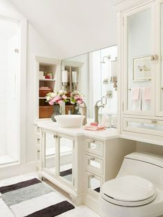 I'm not big on the mirrored cabinets and vanity, but love the storage ideas, especially over the toilet.