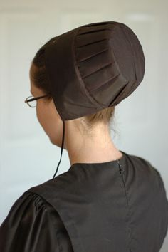 Amish women cover their hair with caps. The color of the cap is indicative of their marital status. Black means the woman is unmarried, white means they are married.