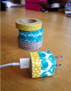 DIY Washi Tape Phone Charger from Sew Trashy. Such an easy way to keep everyone's cords straight! I'll do mine with pink polka-dots... I want to see my husband steal it now...
