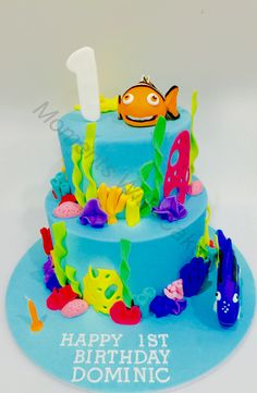Finding Nemo and Dory under the sea birthday cake. Bottom tier is a white mud with white ganache and top tier is chocolate mud with chocolate ganache. Both covered in satin ice fondant.