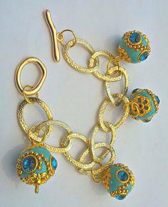 https://www.etsy.com/it/listing/156435219/bracelet-going-to-maroc-materials-golden