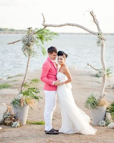 branches, succulents and air plants. beach ceremony altar backdrop. bows and arrows.