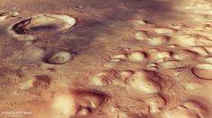 This perspective view in the Colles Nili region on Mars was generated from the high-resolution stereo camera on ESA's Mars Express.The scene is part of region imaged by the High Resolution Stereo Camera on ESA's Mars Express on 29 May 2016 during orbit 15727. The main image is centred on …