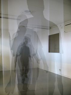 Helsinki-based artist Pia Männikkö observes and recreates physical paths of the human form, depicting small intervals of movement within a space, in her Déjà Vu series. Using tulle fabric and ink, the artist presents a series of ghostly silhouettes cutting through different rooms, as though each flowing panel is a moment frozen in time. Altogether, each site-specific installation exhibits the trail of one man moving from point A to point B. Normally, physical footprints aren't left behind…