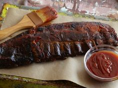 Recipe of the Day: Tyler Florence's Ultimate Barbecued Ribs Bake seasoned ribs low and slow in the oven, baste them with homemade bacon-infused barbecue sauce and then broil them for that charred meaty finish.