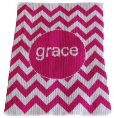 """Eye-Catching Bright stroller blanket is perfect to go from stroller to crib. Years most fashionable and stylish design; Chevron, with her name, initials or nickname.   Shown in fuschia with lettering in white.  Proudly made in the USA!  Stroller Blanket is made of 100% acrylic and is 22"""" x 30"""" this super soft blanket will never fade or shrink. Goes with the child as they grow from infant, to toddler, to pre-school to her tween years. $64.00"""