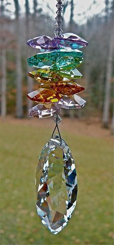From my Board: Sun Catcher/Wind Chimes . Mobiles, Diy And Crafts, Arts And Crafts, Creation Deco, Yard Art, Suncatchers, Bunt, Wind Chimes, Swarovski Crystals