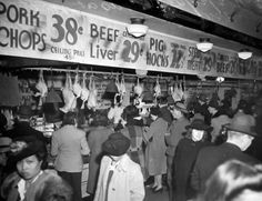 Seattle, WA: A Feb. 20, 1943 scene at the Pike Place Market during a time when there were rations and shortages.