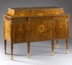 George III marquetry inlaid and gilt-metal-mounted commode, attributed to Matthew and Ince, circa 1775.