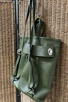 A unique turn lock strap - carry as a backpack or if more room is needed secure strap behind to carry as a tote like this image. The wide bottom makes for a roomy bag to carry a few files or books, iPad, smaller water bottle. The outside back zip pocket fits a passport perfectly. Your items are secure with the zip top. This green is a great neutral - available in several colors. Thick Italian leather - Made in Italy. #womenbag #worktote #tote #summerbag #leatherhandbags #purse #bagsandpurses Italian Leather Handbags, Leather Backpack Purse, Work Tote, How To Make Handbags, Travel Tote, Stitching Leather, Summer Bags, Passport, Neutral