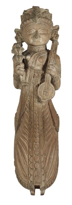 This carved wood female musician holding a flower bud in her right hand and an ektara (one string musical instrument), is originally a strut from a pillar of a wood mansion from north-western India. The figure can be identified as #apsara, the divine dancer and musician of Indian Mythology.#Gujarat, #19thCentury