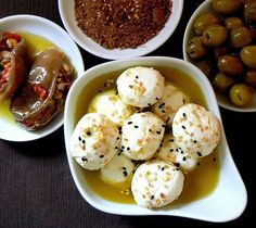 Traditional syrian breakfast - syrian cheese - stuffed eggplant in olive oil - green olives
