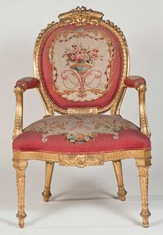 One of a set of eighteen George III giltwood open armchairs by Thomas Chippendale.Additional Information: Originally gilt and upholstered in green silk damask. They were invoiced on November 12 1773