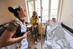 Members of the Red Noses clown doctors perform in a clinic in Slovenia. Since 2004, clown doctors inspired by Patch Adams have visited hospitals and used laughter to help aid the recovery of patients.