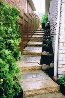 Between houses can often be an awkward place to landscape. These steps make it practical and attractive. Picture compliments of www.ogslandscape.ca
