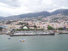 Madeira is a beautiful mountain island of Portugal. City of Funchal in foreground.