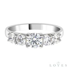 Round brilliant cut diamond in four claw setting with two graduated round brilliant diamonds set either side. A side view of this elegant ring showcases the beauty of the center stone diamond allowing the diamonds cut to be viewed from every angle. see more at http://loyesdiamonds.ie/ring/nina-multi-stone-engagement-ring