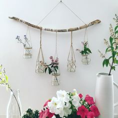 Items similar to flower hanger candles eco friendly wall decoration wall art flower decoration floating wood hanging flowers candlesticks on Etsy Jewelry Storage Solutions, Rama Seca, Mirror Crafts, Boho Dekor, Diy Gifts For Friends, Jewelry Hanger, Painted Sticks, Mural Wall Art, Hanging Flowers