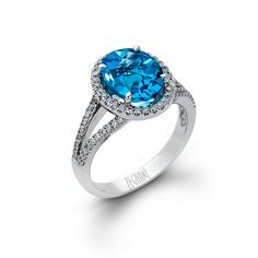 This beautiful 14K white gold split shank fashion ring comes with 3.65ctw of white Blue Topaz and .39ctw of white round diamonds and can be found in our Delicate Diva Collection.