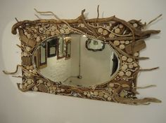 Beautifully decorated driftwood mirror.