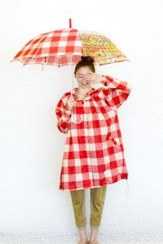 Cute rain coat and a happy umbrella