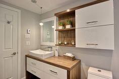 I like the general look of the cabinets and vanity, but not a fan of the raised sink. Bathroom Kids, Bathroom Renos, Small Bathroom, White Vanity Bathroom, Best Bathroom Vanities, Apartment Furniture, Bathroom Furniture, Washbasin Design, Room Inspiration
