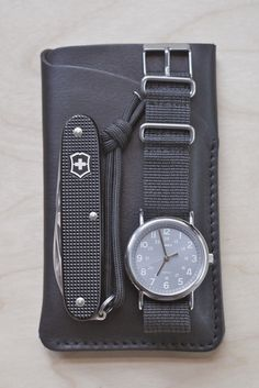 Black Titanium Victorinox, Black Shock Proof Timex Featuring Black Woven Strap, Black Leather Pouch, Black Efficiency