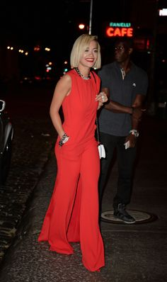 Rita Ora wears a ELIE SAAB PreFall 2013, red jumpsuit with a draped bodice and a long sweeping train in New York.