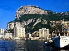 This literal rock hanging off the coast of southern Spain is a British Overseas Territory with a population of 30,000 people and, in some seasons, what feels like just as many yachts. Nonstop flights from London land on its single runway, which straddles the only road into and out of the country towards Spain. Gibraltar's chief attraction is its own topography