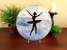 Ballerina silhouette on blue fluid painted vinyl record.