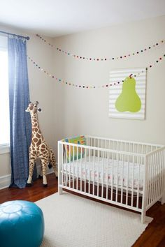 Add visual interest to a nursery by stringing the garland across the ceiling for your little one to look at.