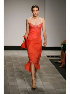 Reed Krakoff coral fitted dress with leather bodice shown during Mercedes Benz Fashion Week Spring/Summer 2013 in New York City. #models #fashion #NYFW