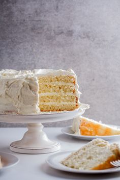 Soft and fluffy lemon yoghurt cake sandwiched with sweetened whipped cream and snowy white chocolate frosting.