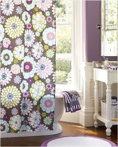 I like the idea of a pretty girly color with pops of color in  the shower curtain etc