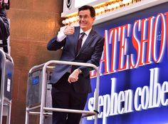 Stephen Colbert from The Big Picture: Today's Hot Pics  The late-night host  changes a light bulb on The Ed Sullivan Theater marquee in NYC.