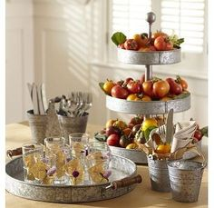 Pottery Barn galvanized metal serving pieces http://www.potterybarn.com/products/galvanized-metal-rivet-tiered-stand/?cm_src=AutoRel
