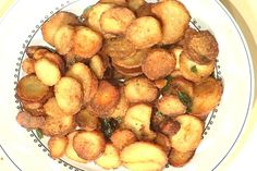 Taro Root discs deep fried and seasoned with Salt, Red Pepper, and fried Curry Leaves