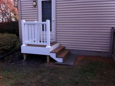 Back Door Steps with Landing | ... composite decking and white vinyl railing with concrete landing