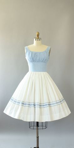 Vintage 50s Norma Gini blue and white gingham print cotton sundress. Shelf bust. Full skirt. Metal zipper up back. Skirt is not lined and is