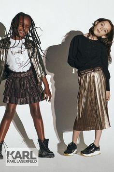 Love! Black long sleeve shirt with Karl's beloved cat Choupette on the front in shiny, mirror-effect gold and a white logo print on the back. Shimmering Art Deco-inspired gold pleated skirt with an elasticated gold logo waistband. Inspired by the Karl Lagerfeld Women's Collection featured on the runway at Paris Fashion Week. Shop @ Childrensalon (affil). #karllagerfeld #girlsgoldskirt #minime #designergirlsclothes #dashinfashion