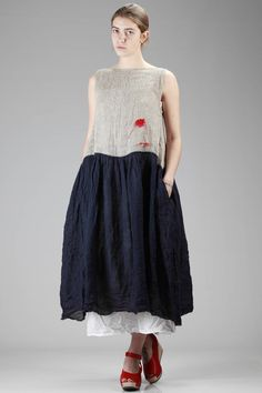 Daniela Gregis | long and wide dress with natural linen bodice and navy embossed linen gauze skirt |