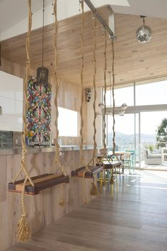 Swing bar stools from Dot & Bo mounted from the ceiling in this 3-level home in San Francisco