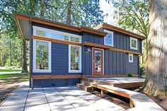 This is the 399 sq. ft. Salish Cottage at Wildwood Lakefront Cottages. When you step inside, you'll find a living area, dining area, kitchen, downstairs bedroom, laundry, bathroom, and an ups…