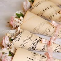 I love vintage -- lace, pearls, music sheets, roses, etc. This is a cute idea for favors or small gifts or even decor.
