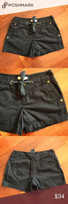 """Michael Kors Cotton Shorts In excellent condition. Black shorts with button and tie by Michael Kors. Size 4. 100% Cotton. Waist: 14.5"""" across. Inseam: 5"""". Length top to bottom: 13"""". MICHAEL Michael Kors Shorts"""