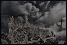 """""""James Nachtwey's photograph here of one tiny New York City fireman making his way through the inferno that was once the World Trade Center towers is forever seared into my memory from the darkest day in American history, 9/11/2001."""" - MaryAnne Golon, photo editor and media consultant; former Director of Photography of TIME (118)"""
