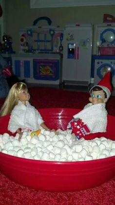 Ollie has a bubble bath with Barbie!  Elf on the Shelf.