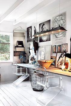 my scandinavian home // bohemian workspace with rough wood plank desk and clear lucite chairs