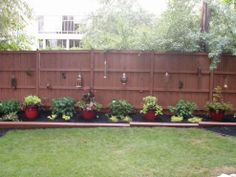 Using stain, lanterns, and a couple accent pots you can completely transform an outdoor space.
