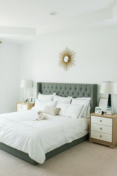 neutral bedroom with a sunburst mirror | Shea Christine